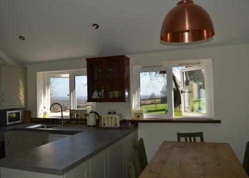Kitchen and Dining Area at Farmhouse Cottage